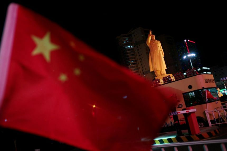 A Chinese flag flutters near a statue of late Chinese chairman Mao Zedong at a train station in China, Oct 5, 2019. In the half century since 1970, Asia has witnessed a profound transformation.