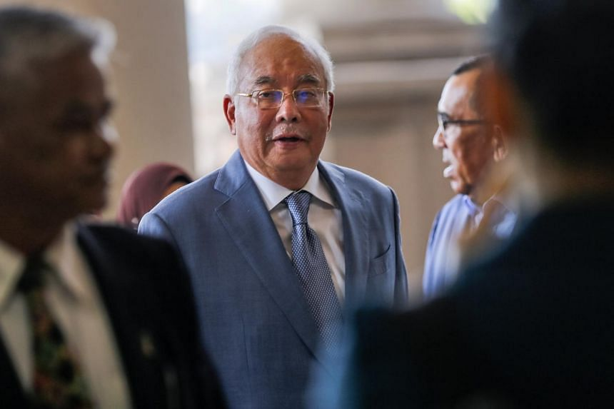 A photo taken on Oct 16 shows former Malaysian Prime Minister Najib Razak arriving at the High Court in Kuala Lumpur.