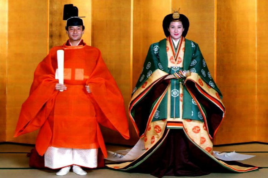 An Imperial Palace file photo taken on June 2, 1993 shows Japanese then Crown Prince Naruhito (left) and his bride, Masako Owada. The new emperor took the throne earlier this year but the proclamation ceremony cements the transition in stunning style