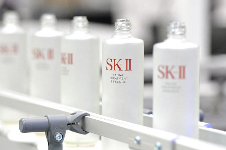 Automated inspection line of SK-II bottles using AI, instead of manual labour, at P&G's production plant.