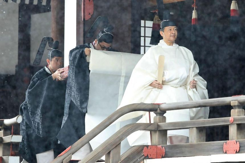 Japan's Emperor Naruhito (right) leaves Kashikodokoro sanctuary after reporting his enthronement to his imperial ancestors at a shrine on the palace grounds during a ritual at the Imperial Palace in Tokyo on Oct 22, 2019.