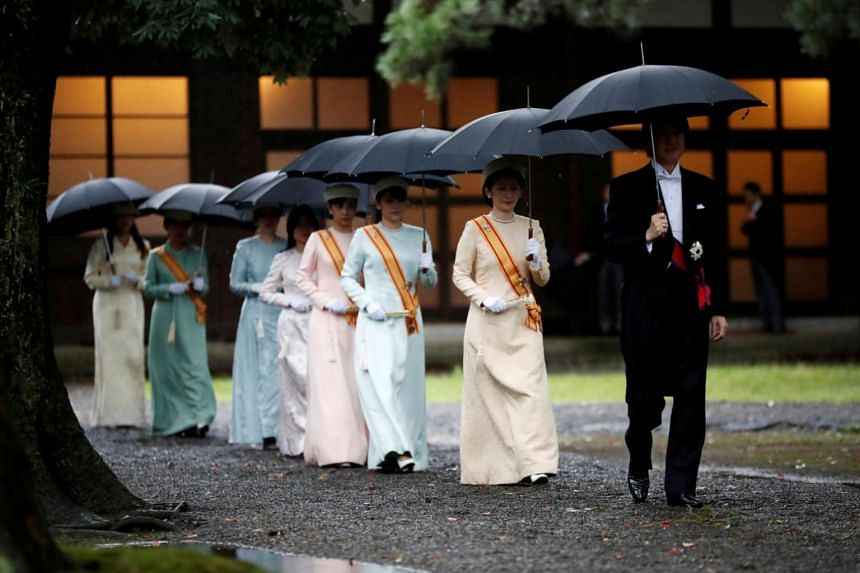 Japan's Prince Akishino and Princess Kiko arrive at the ceremony site where Emperor Naruhito will report the conduct of the enthronement ceremony at the Imperial Sanctuary inside the Imperial Palace in Tokyo, Japan on Oct 22, 2019.