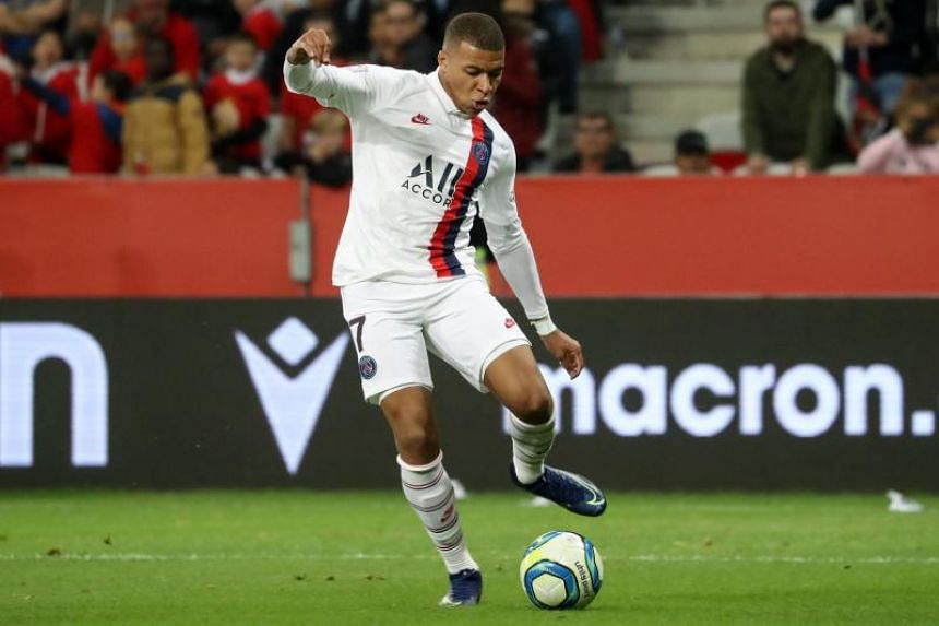 Paris Saint-Germain's French forward Kylian Mbappe passes the ball during the French L1 football match between OGC Nice and Paris Saint-Germain at the Allianz Riviera stadium in Nice, France, on Oct 18, 2019.