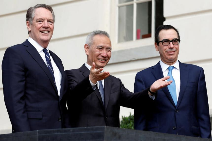 In a photo taken on Oct 10, 2019, Chinese Vice-Premier Liu He (centre) gestures to the media between US Trade Representative Robert Lighthizer (left) and Treasury Secretary Steve Mnuchin before the two countries' trade negotiations in Washington, DC.