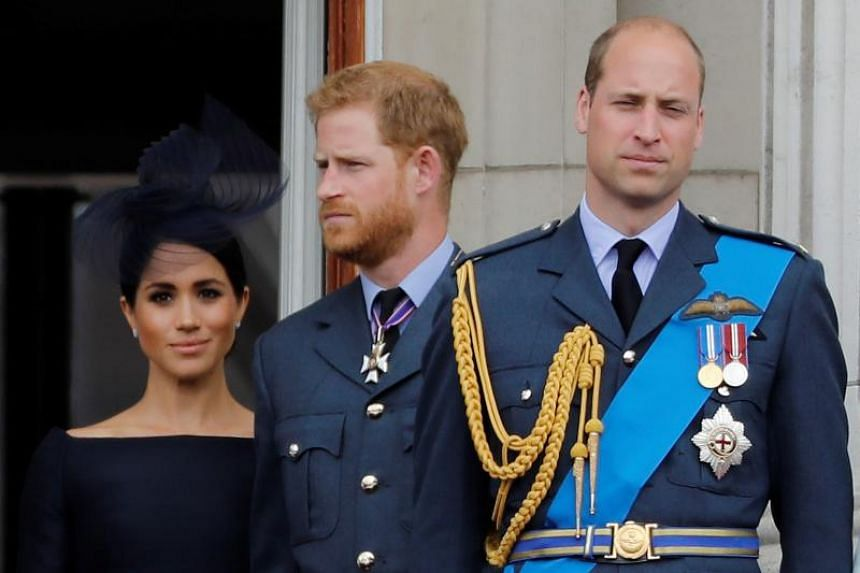 In this file photo taken on July 10, 2018, (from left) Britain's Meghan, Duchess of Sussex, Britain's Prince Harry, Duke of Sussex and Britain's Prince William, Duke of Cambridge, stand on the balcony of Buckingham Palace to watch a military fly-past