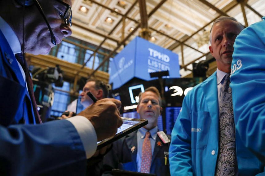 Traders work on the floor at the New York Stock Exchange in New York on Oct 21, 2019.