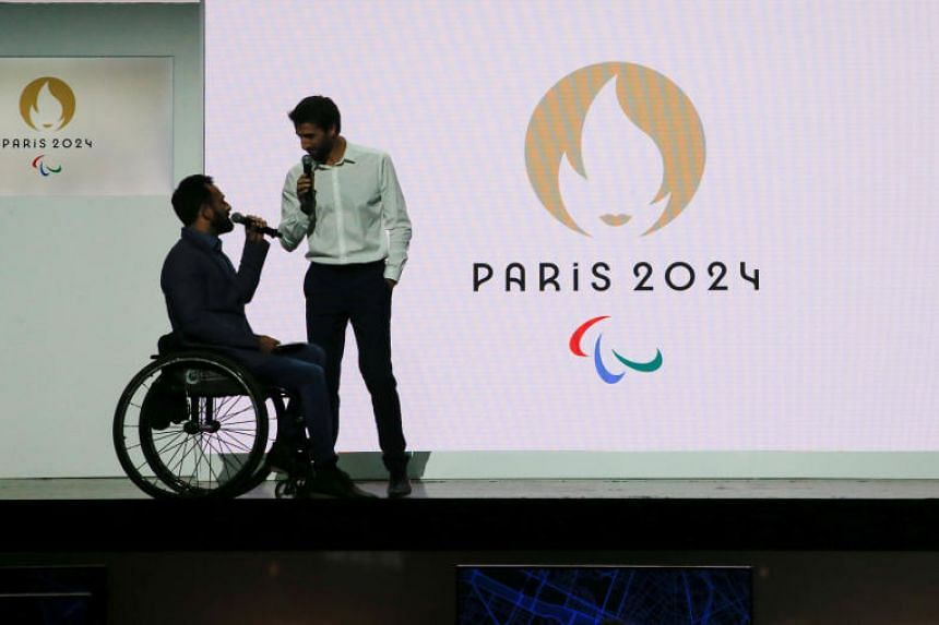 Tony Estanguet, President of the Paris Organising Committee of the 2024 Olympic and Paralympic Games, and paralympic athlete Michael Jeremiasz speak during a ceremony to present the new logo of the Paris 2024 Olympics in Paris on Oct 21, 2019.