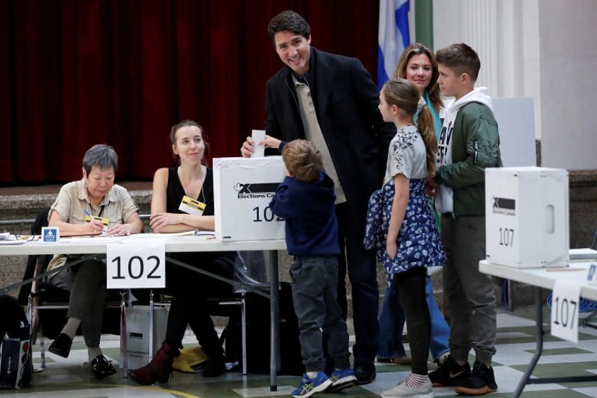 Canadian Prime Minister Justin Trudeau, accompanied by his wife and children, votes in the federal election in Montreal.