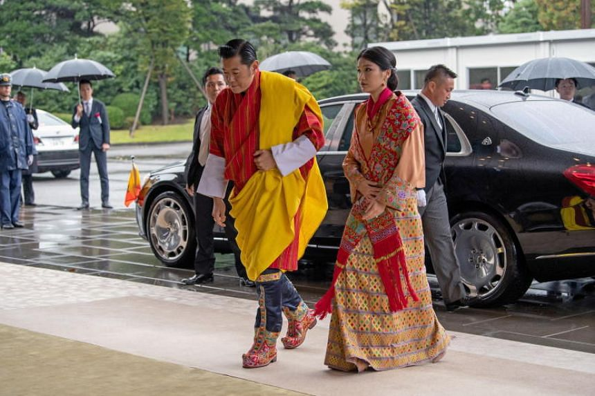 King Jigme Khesar Namgyel Wangchuck and Queen Jetsun Pema of Bhutan arrive at the Imperial Palace in Tokyo to attend the enthronement ceremony of Japan's Emperor Naruhito on Oct 22, 2019.
