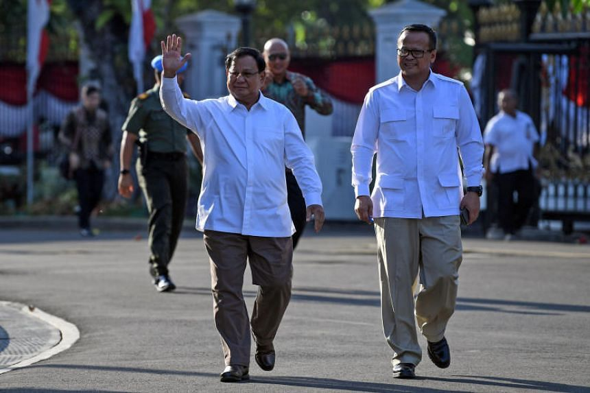 Head of the Gerindra Party Prabowo Subianto and his deputy Edhy Prabowo arrive at the Presidential Palace in Jakarta on Oct 21, 2019.