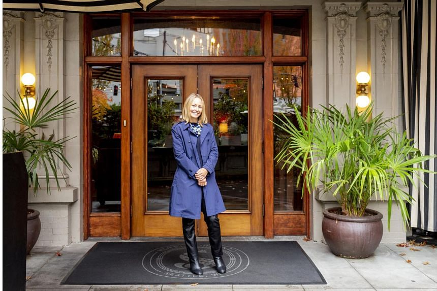 Barbara Malone, co-owner of the 110-year-old Hotel Sorrento, stands in front of it main entrance in Seattle, on Oct 17, 2019.
