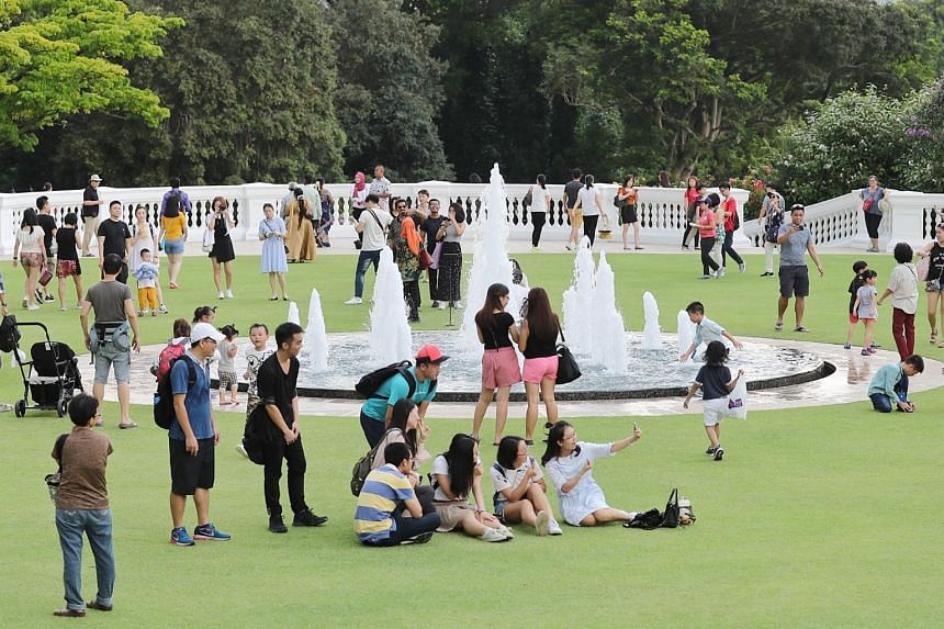People enjoying the Istana grounds at the Deepavali Istana Open House last year on Nov 6.