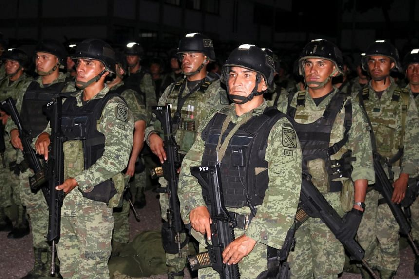 Members of a special unit of the Mexican Army are seen at a military zone as part of an operation to increase security after cartel gunmen clashed with federal forces in Culiacan, Mexico on Oct 20, 2019.