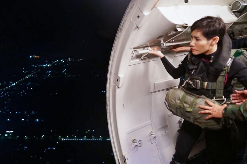 Former royal noble consort Sineenat Wongvajirapakdi looking out of a military plane in a photo released on Aug 26, 2019.