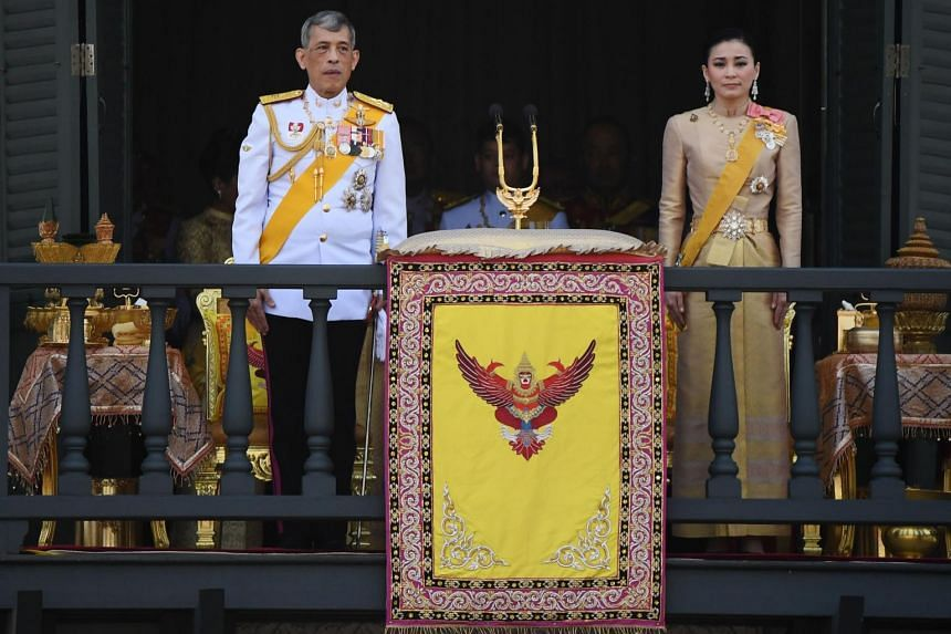 Thailand's King Maha Vajiralongkorn and Queen Suthida appear on the balcony of the Grand Palace in Bangkok, on May 6, 2019.