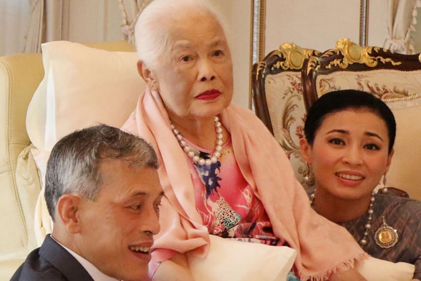 A photo released on Aug 12, 2019, shows Thailand's Queen Mother Sirikit (centre) sitting with King Maha Vajiralongkorn and Queen Suthida during a ceremony on her 87th birthday at the Chitralada Palace in Bangkok.