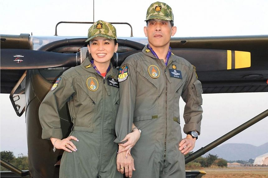 A photo released on May 19, 2019, showing Thai King Maha Vajiralongkorn and Queen Suthida posing for a photo in military attire.