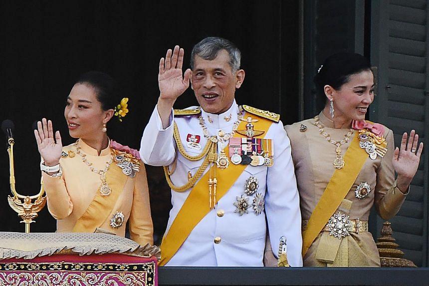 Thai King Maha Vajiralongkorn, his daughter Princess Bajrakitiyabha Mahidol (left) and Queen Suthida waving from the balcony of the Grand Palace on Bangkok, on May 6, 2019.