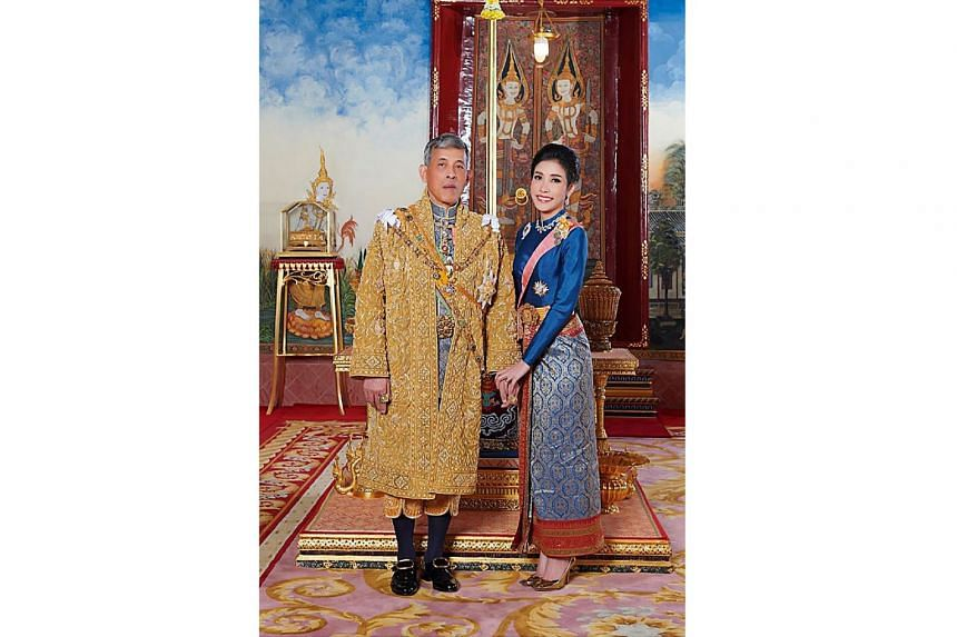 A file photo of Thailand's King Maha Vajiralongkorn with his then Royal Noble Consort Sineenat Wongvajirapakdi. The 34-year-old former nurse was bestowed the title on the King's 67th birthday in July.