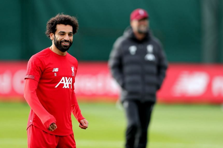 Salah takes part in training ahead of the match against Genk.