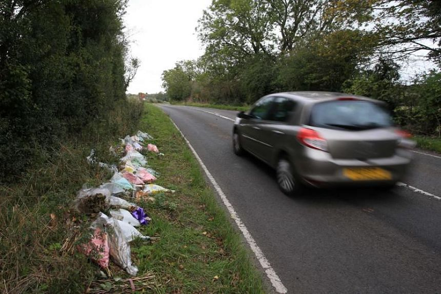 A photo taken on Oct 19 shows floral tributes on the roadside in Northamptonshire, England, at the spot where British motorcyclist Harry Dunn was killed on Aug 27.