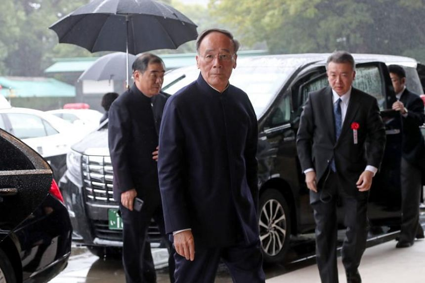 China's Vice-President Wang Qishan arrives at the Imperial Palace in Tokyo to attend the enthronement ceremony of Japan's Emperor Naruhito on Oct 22, 2019.