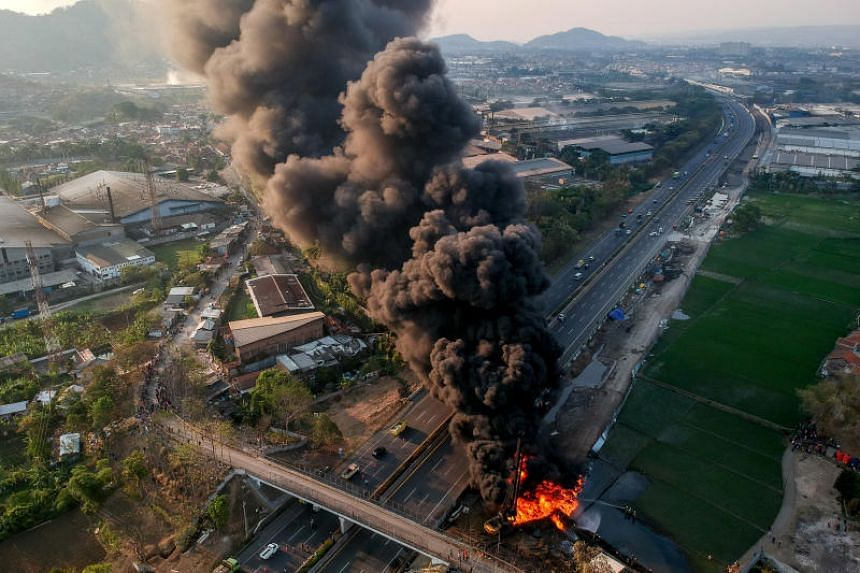 An aerial view of a fire on a pipeline owned by PT Pertamina in Cimahi near Bandung, Indonesia, on Oct 22, 2019. According to a local fire official, a Chinese construction worker was killed in the accident.