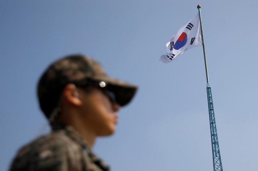 In a photo taken on Sept 30, a soldier stands guard in Paju, South Korea.