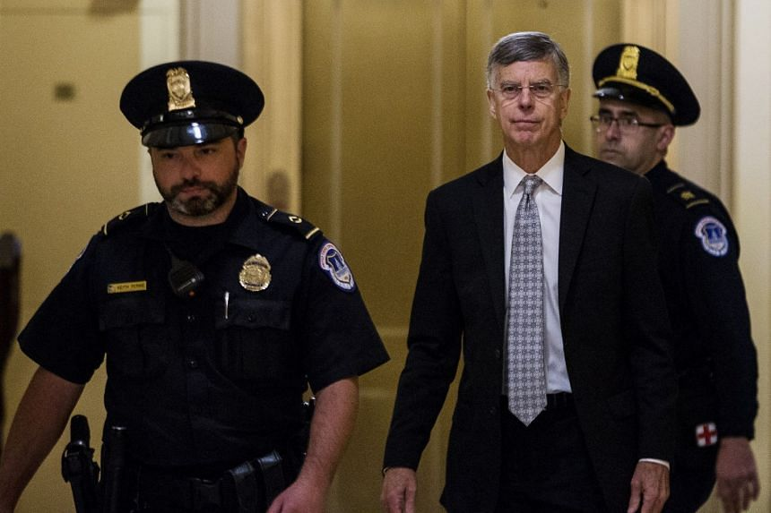 Taylor arrives to testify before House committees on Capitol Hill in Washington.