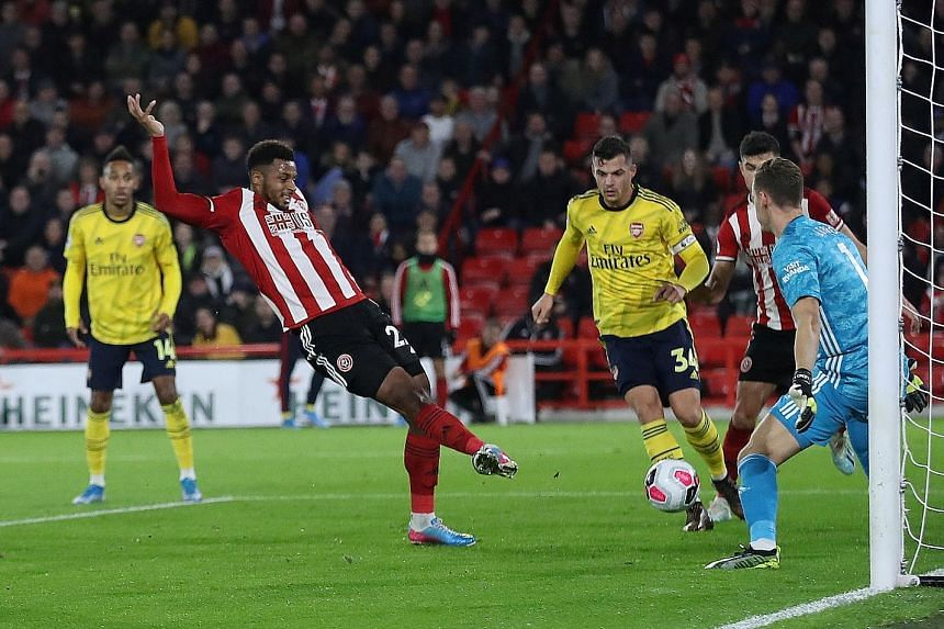 Sheffield United's Lys Mousset scoring the winner against Arsenal in the 1-0 Premier League win on Monday. A clean sheet for his team also meant that Sheffield and leaders Liverpool have conceded only seven goals each so far, the fewest among all 20