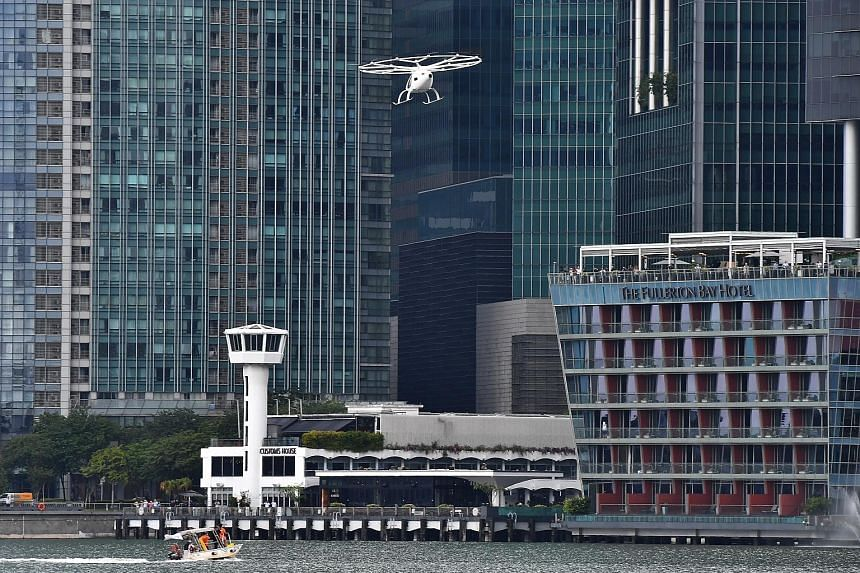 An 18-propeller drone-like flying taxi took to the skies here for the first time yesterday, as German firm Volocopter conducted a test flight of its vehicle around the Marina Bay district. The battery-operated, two-seater vehicle flew for about two m