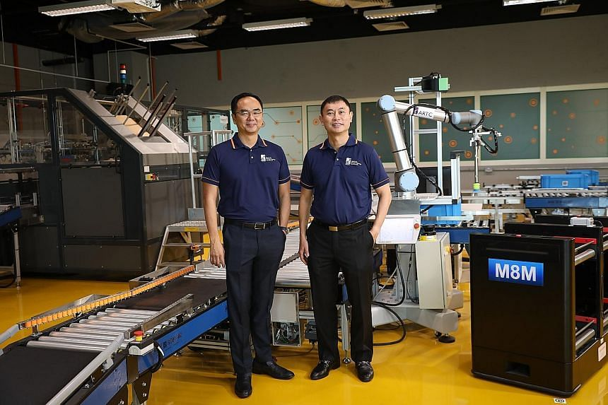 (From left) Dr David Low, chief executive of A*Star's Advanced Remanufacturing and Technology Centre, and Professor Tan Sze Wee, assistant chief executive of A*Star's Science and Engineering Research Council. ST PHOTO: ONG WEE JIN