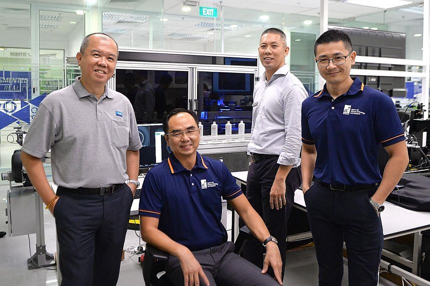 The creators of the automated inspection system for SK-II bottles include (from left) M8M co-founder and director Chua Choon Beng, ARTC chief executive David Low, JM Vistec System managing director Eugene Goh and ARTC group manager of intelligent pro