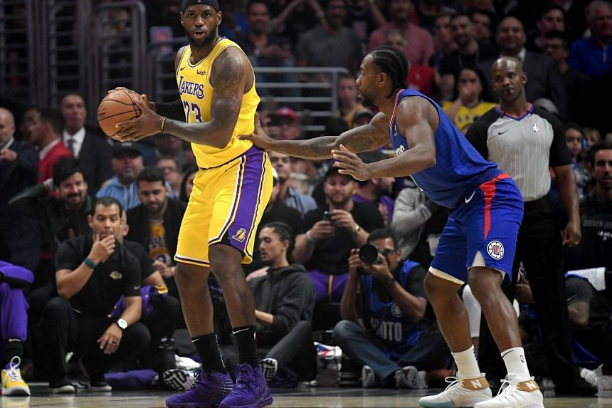 LeBron James of the Los Angeles Lakers is defended by Kawhi Leonard of the LA Clippers in the latter's season home opener at Staples Centre on Oct 22, 2019 in Los Angeles, California. The Clippers won 112-102.