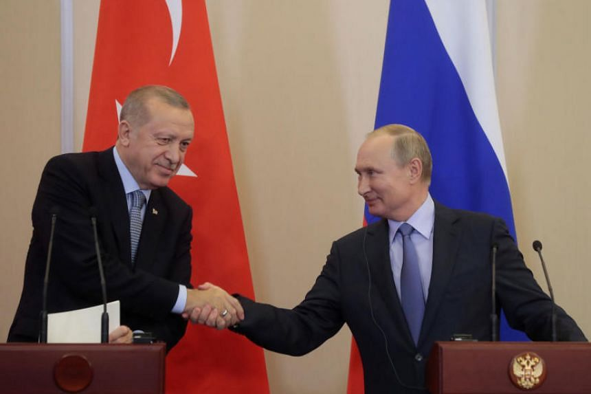 Russian President Vladimir Putin (right) with Turkish President Recep Tayyip Erdogan during their joint news conference following Russian-Turkish talks in the Black sea resort of Sochi, Russia, on Oct 22, 2019.
