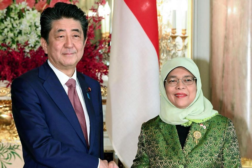 Japan's Prime Minister Shinzo Abe and Singapore's President Halimah Yacob met at a 15-minute closed-door bilateral summit at the Akasaka State Guest House in Tokyo on Oct 23, 2019.