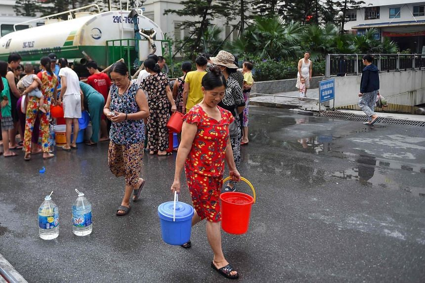 An estimated one million people are reeling from a contaminated tap water crisis after a brick factory was blamed for dumping oily sludge into a river that supplies several Hanoi neighbourhoods.