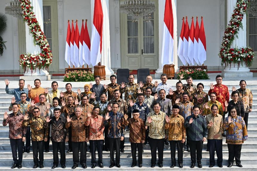 Indonesian President Joko Widodo and Vice-President Ma'ruf Amin (front row, sixth and seventh from left) with members of their new Cabinet on the steps of the Merdeka Palace in Jakarta on Oct 23, 2019.