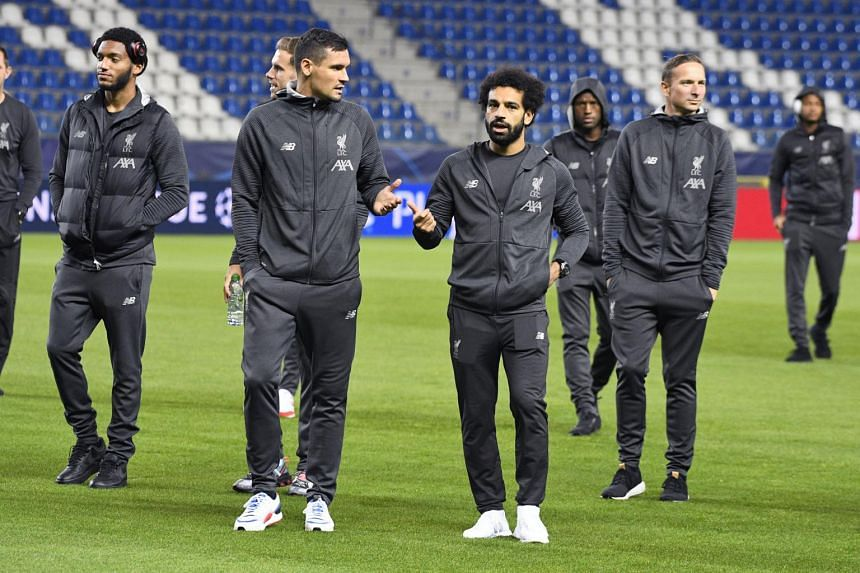 Liverpool's Mohamed Salah (right) and Dejan Lovren at a training session ahead of the Champions League clash against KRC Genk.