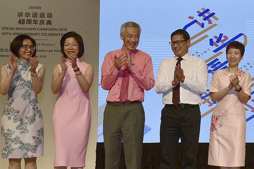 Prime Minister Lee Hsien Loong at an event to mark the Speak Mandarin Campaign's 40th anniversary, with (from left) National Heritage Board chief executive Chang Hwee Nee, Senior Minister of State for Information and Culture, Community and Youth Sim
