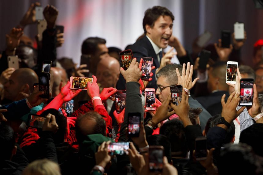 Supporters trying to get a photo of Prime Minister Justin Trudeau as he arrived to deliver his victory speech in Montreal on Monday.