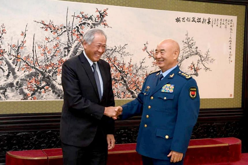 Minister for Defence Dr Ng Eng Hen shakes hands with the Vice Chairman of the Central Military Commission General (GEN) Xu Qiliang on Oct 21, 2019, in Beijing.