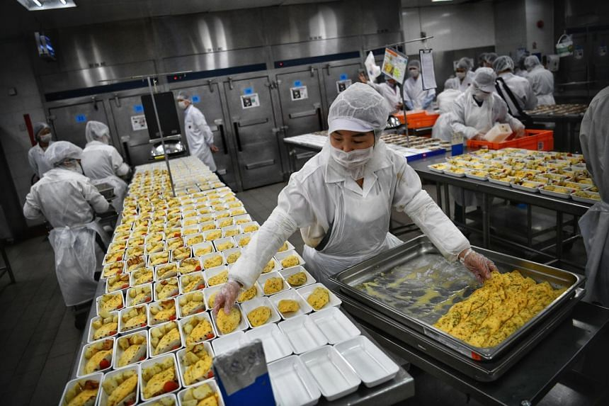 Food handlers with masks on at the SATS inflight catering centre.