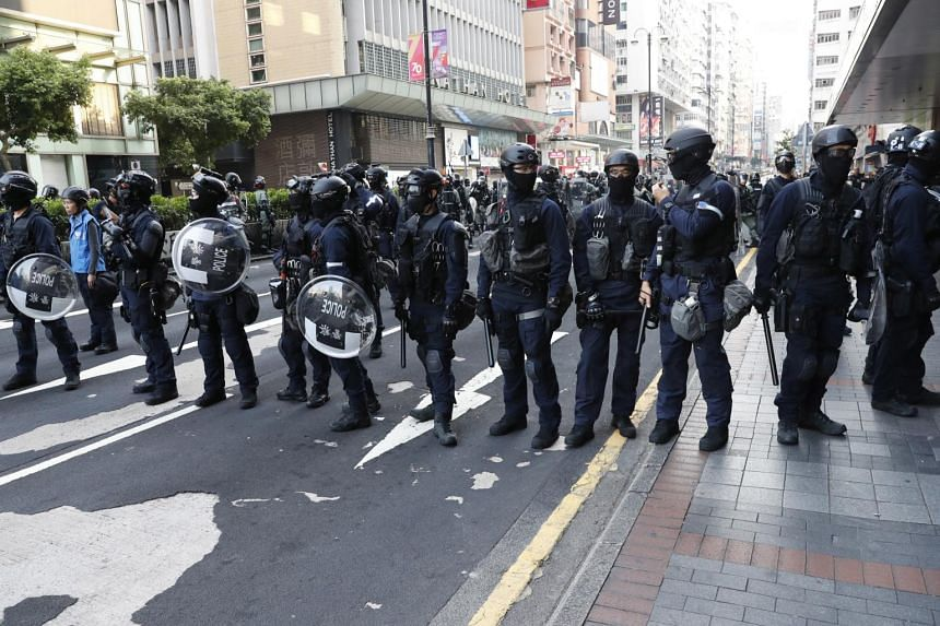 Riot police standing guard on a street during a rally against an anti-mask law in Hong Kong, on Oct 20, 2019.