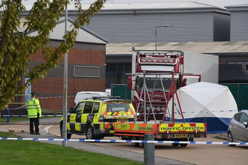 Police officers in forensic suits were seen inspecting a large white container on a red truck next to warehouses at the site at Waterglade Industrial Park in Grays, England.