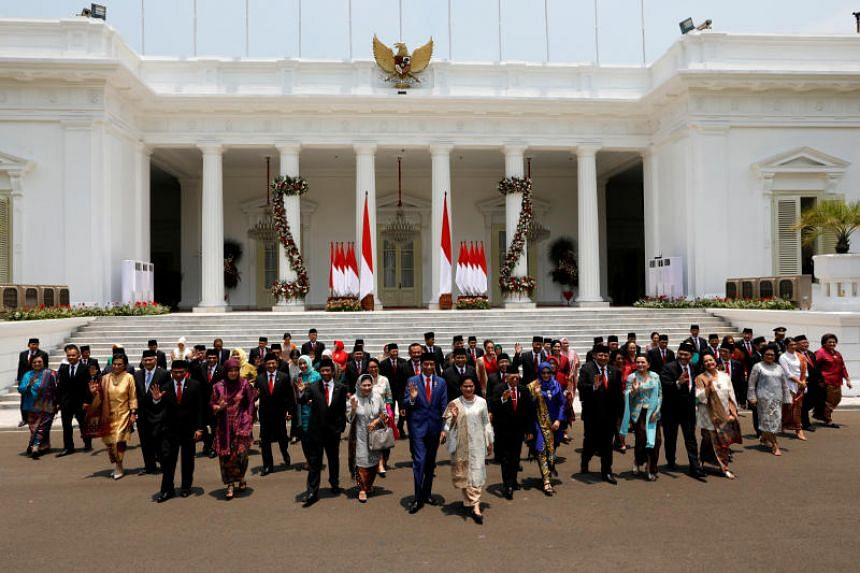 """Indonesian President Joko Widodo's and his new """"Onward Indonesia Cabinet"""" at the Presidential Palace in Jakarta, Indonesia, on Oct 23, 2019."""