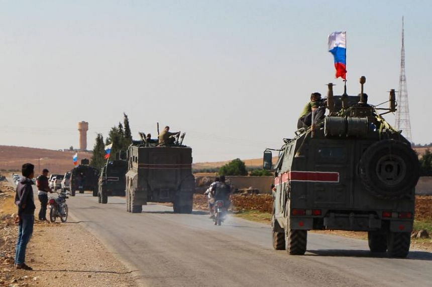 A convoy of Russian military vehicles heading towards the north-eastern Syrian city of Kobane on Oct 23, 2019.