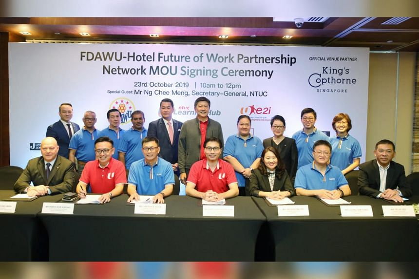 Representatives from some of the 18 hotels, the Food, Drinks and Allied Workers Union, NTUC's Employment and Employability Institute, and NTUC's Learning Hub at the signing ceremony for the  FDAWU-Hotel Future of Work Partnership Network on Oct 23, 2