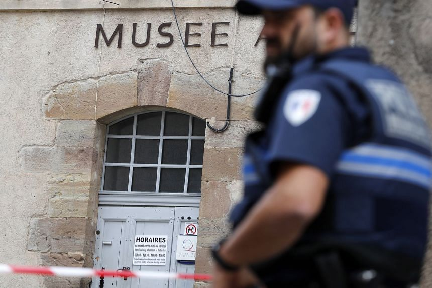 Police cordons off an area at the museum in Saint-Raphael, southern France.