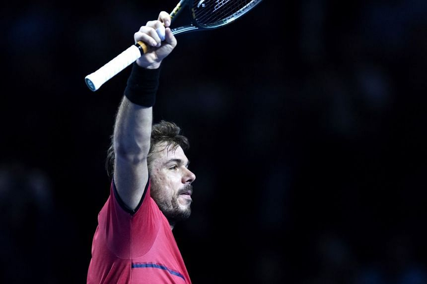 Wawrinka cheers after winning his first round match against Uruguay's Pablo Cuevas.